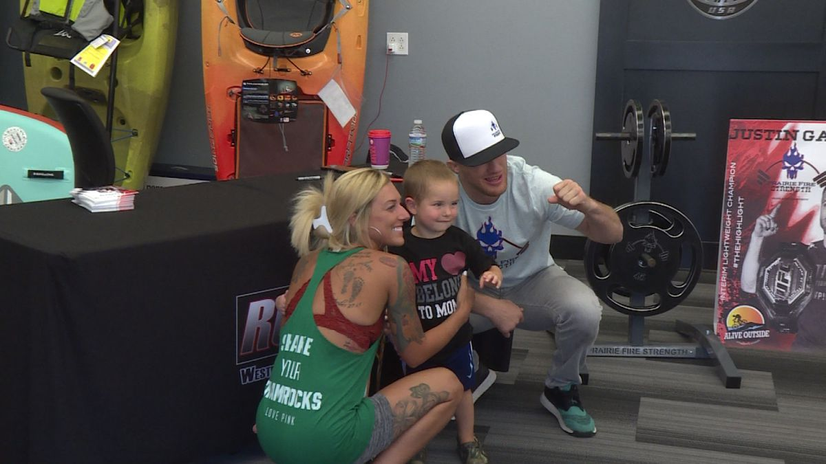 Justin Gaethje takes a photo with some young fans at Alive Outside recreation store. (Credit:Sam Pirozzi/KNOP-TV)