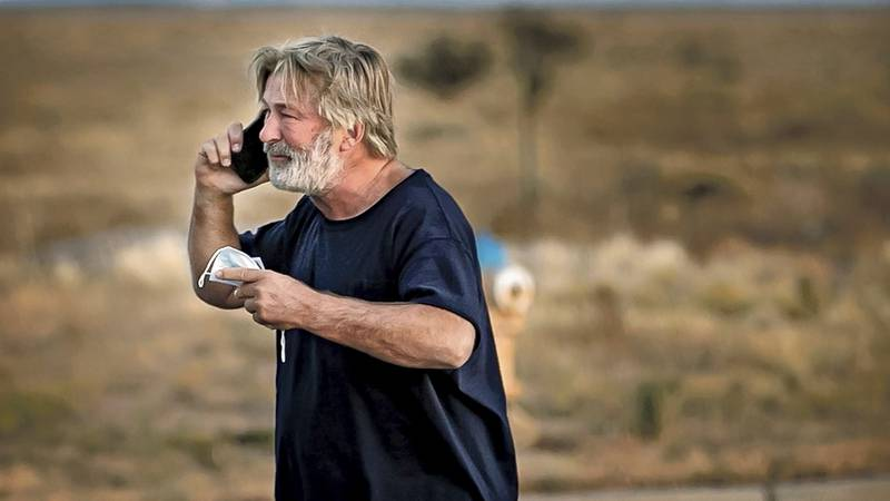 Alec Baldwin speaks on the phone in the parking lot outside the Santa Fe County Sheriff's...