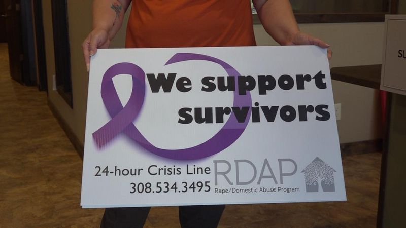 RDAP sign raising awareness about domestic violence in community.