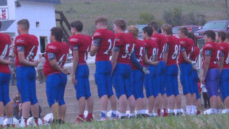 Medicine Valley football lined up.