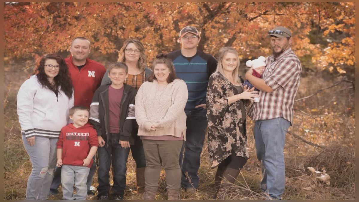 Cynthia Huhman, of Merna, stands with her family who inspired her to earn two associate degrees through MPCC at age 52. Pictured left to right are: Huhman's daughter-in-law JaLisa, son Ryan, grandson Ryker, son Timmy, Huhman, daughter Bethany, son Reece, daughter Brittany, granddaughter Delilah and Brittany's fiancé Jesse Toof. (Photo courtesy of Hillary Williams Photography)