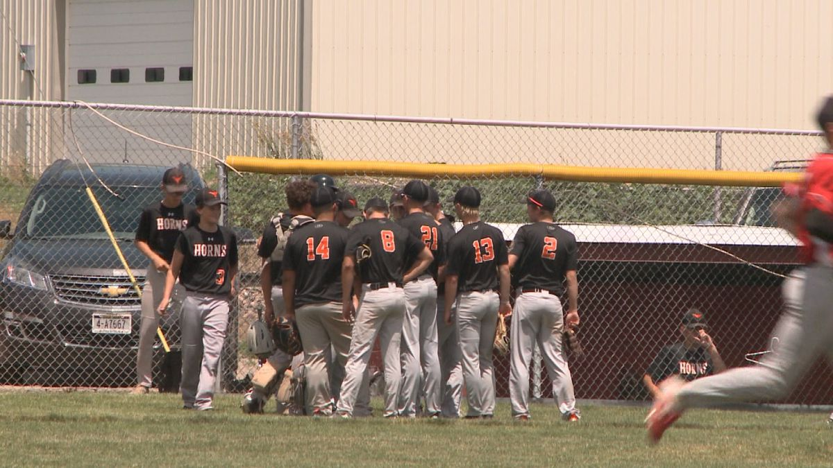 Imperial baseball huddles up in front of dugout before taking the field.<br />(Credit:Sam Pirozzi/KNOP-TV)
