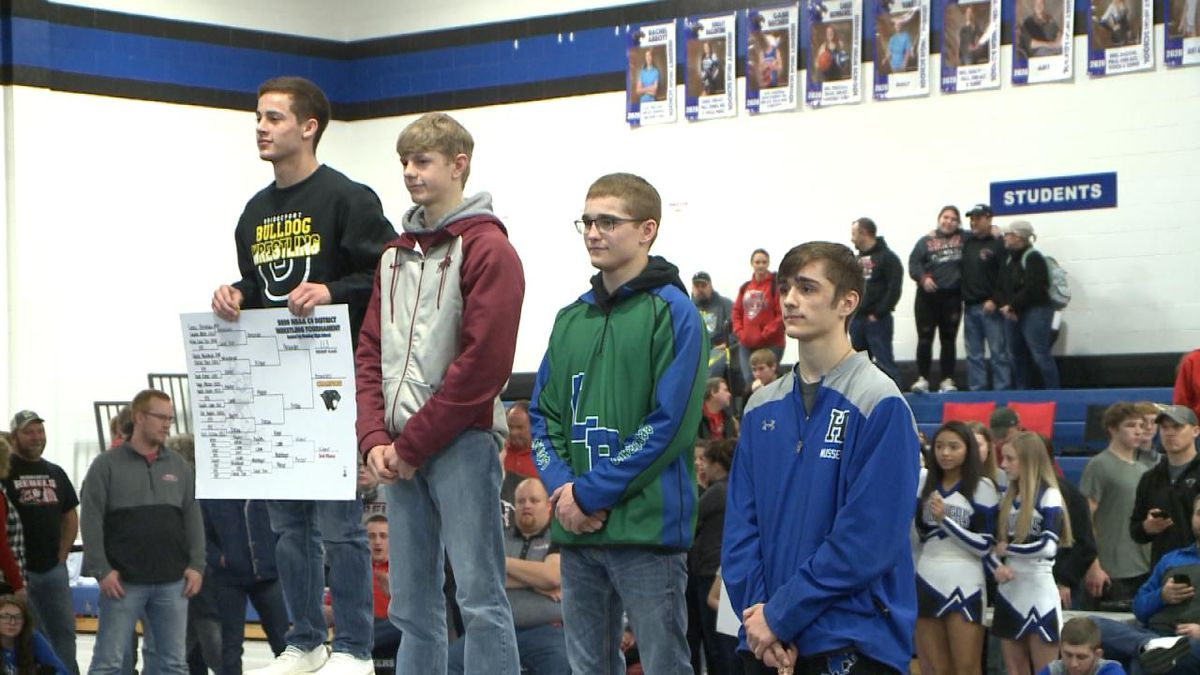 Wrestlers receive their medals at the conclusion of meet. <br />(Credit: Sam Pirozzi/KNOP-TV)