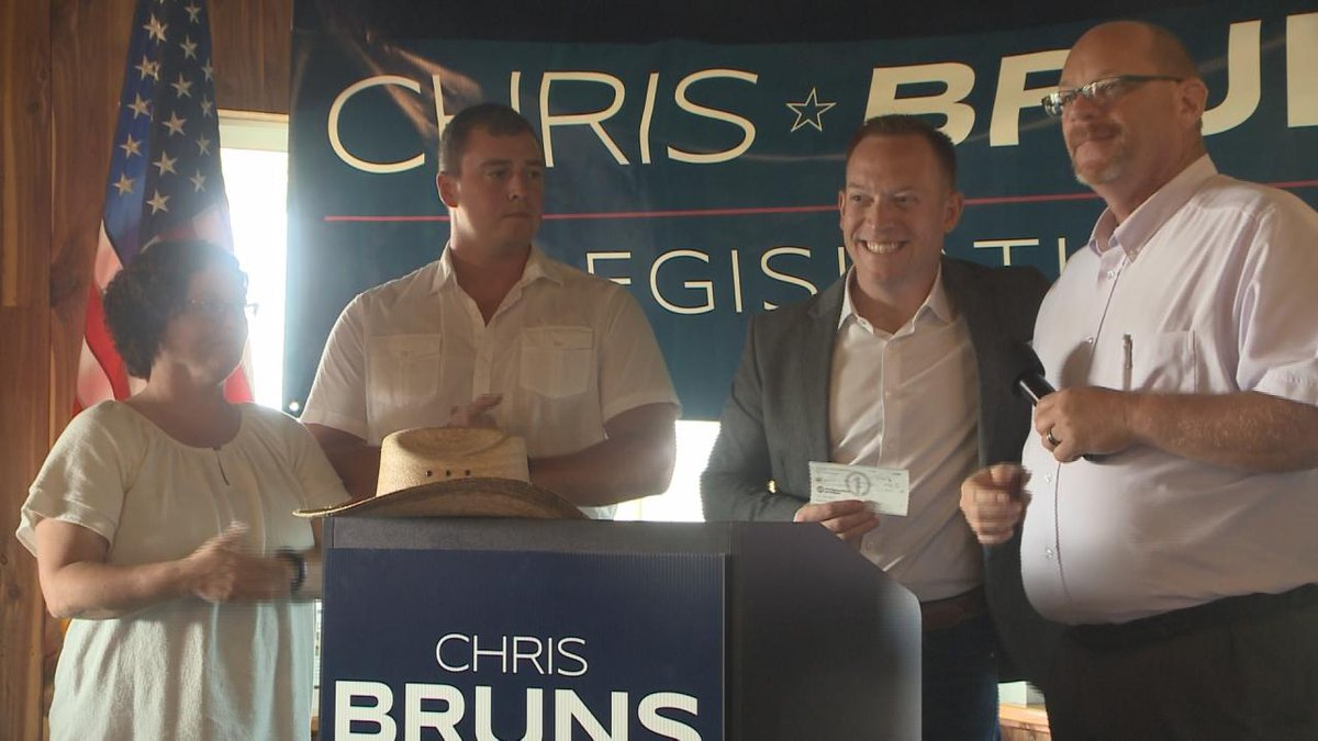 District 42 candidate Chris Bruns receives a $500 donation from the Fraternal Order of Police...