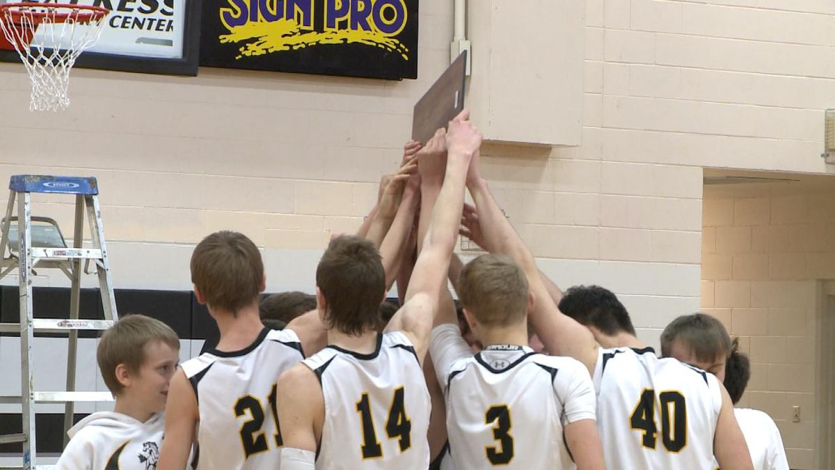 Mullen raises their district championship trophy after the game.<br />(Credit: Sam Pirozzi/KNOP-TV)