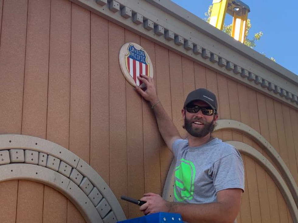 Jarod Cole, senior manager-System Locomotive Facility, Mechanical, adds finishing touches to...