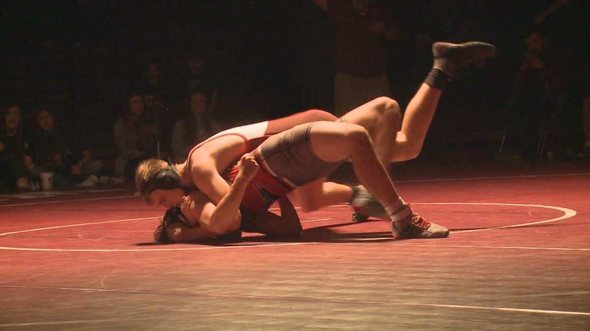 Riley Baker pins Cauyer Glanz during meet Friday night. Baker won the match 8-0. (Credit: Sam Pirozzi, KNOP-TV)