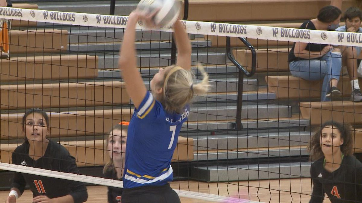 North Platte's Peyton Neff goes up for the set against Ogallala Thursday.