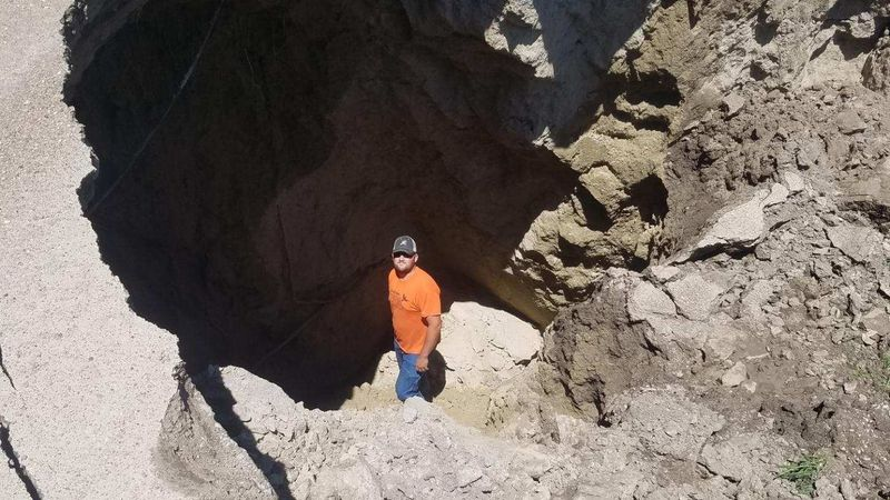 A Lincoln County road is washed away by July rains.  Lincoln County Commissioner Joe Hewgley...