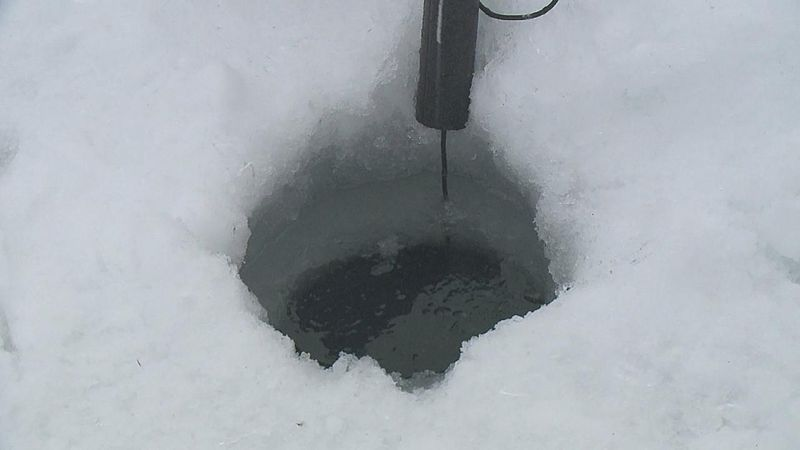 Close up of hole created by ice-fisherman
