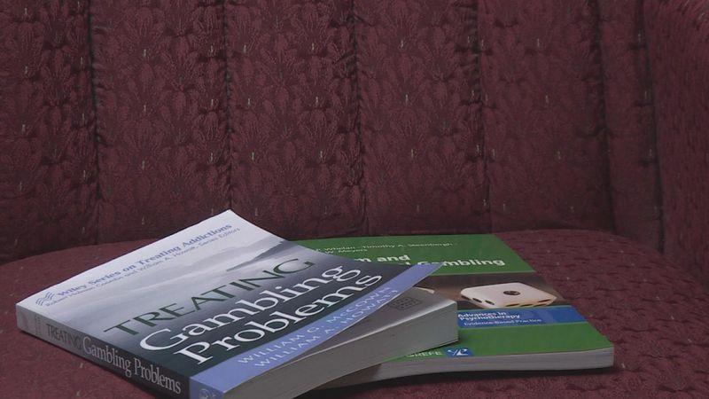A close up on books regarding gambling addictions belonging to Certified Gambling Counselor Ron...