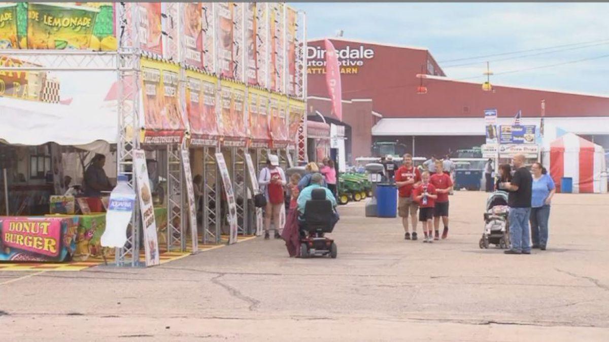 State Fair goers walk through food vendors, enjoying a nice day at Fonner Park. (Credit: Alicia Naspretto, KSNB)